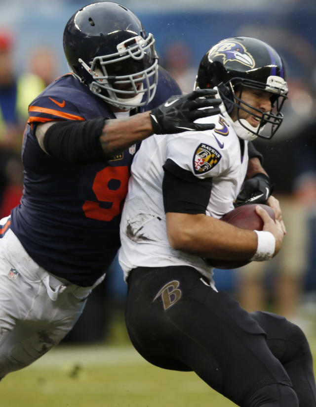 Chicago Bears defensive end Julius Peppers (90) sacks Baltimore Ravens quarterback Joe Flacco (5) during the first half of an NFL football game, Sunday, Nov. 17, 2013, in Chicago. (AP Photo/Charles Rex Arbogast)