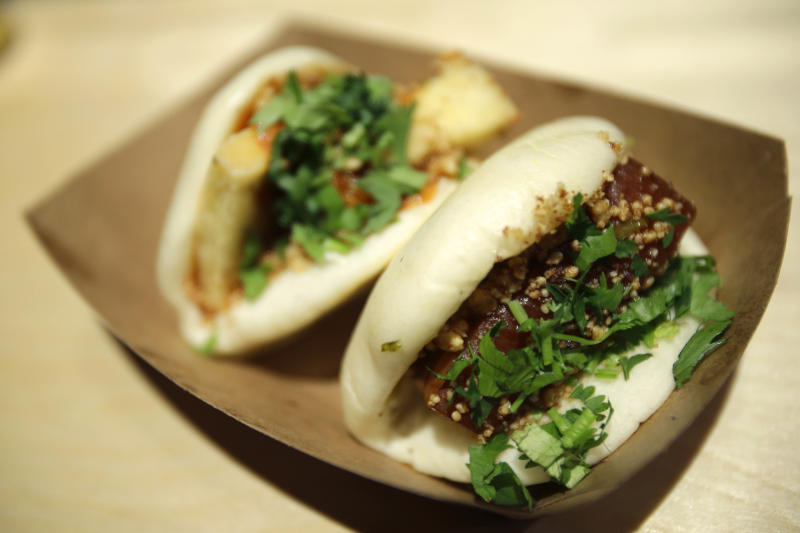 This Monday, Jan. 28, 2013 photo shows the Chairman Bao and Uncle Jesse bao at chef Eddie Huang's Baohaus in New York. (AP Photo/Seth Wenig)