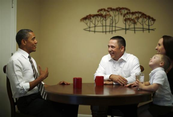 President Obama meets with Jason and Ali McLaughlin and their son Cooper in the dining room of their home in Cedar Rapids, Iowa, July 10, 2012.