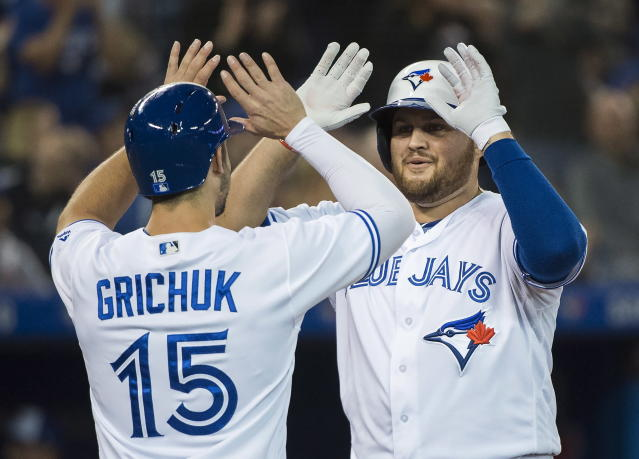 Toronto Blue Jays' Rowdy Tellez, right, celebrates with Randal Grichuk (15) after hitting a two-run home against the Tampa Bay Rays during the second inning of a baseball game in Toronto on Thursday, Sept. 20, 2018. (Nathan Denette/The Canadian Press via AP)