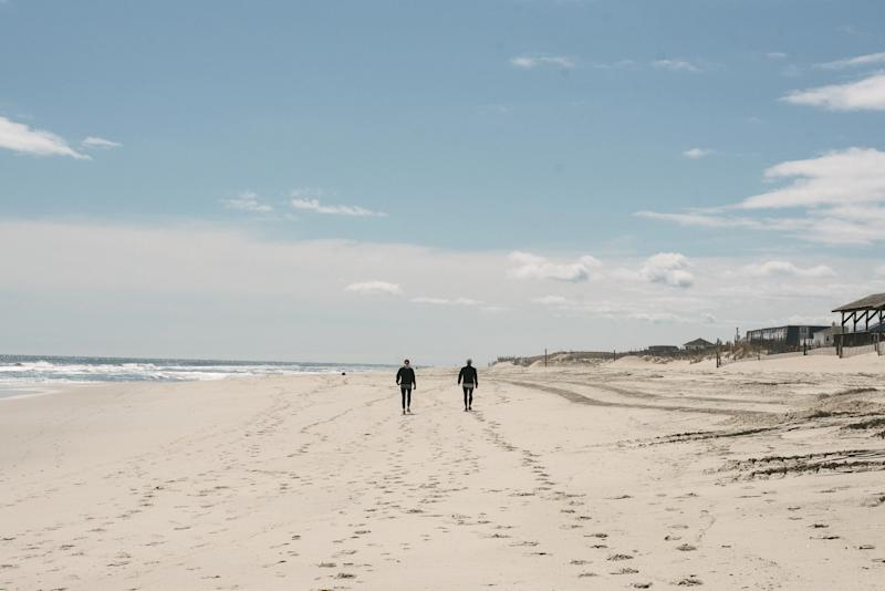 Two women from Pennsylvania walk near Beach Haven on Long Beach Island, N.J. on March 24, 2020. (Hannah Yoon for The New York Times)