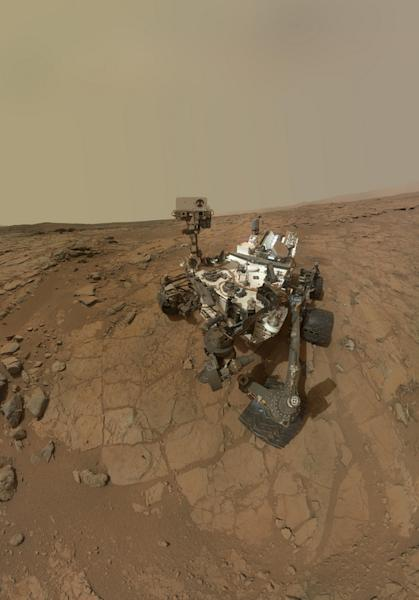 "This self-portrait of NASA's Mars rover Curiosity combines dozens of images taken by the rover's Mars Hand Lens Imager on Feb. 3, 2013. The portrait was taken at the rock target ""John Klein,"" where the rover collected the first ever bedrock sa"
