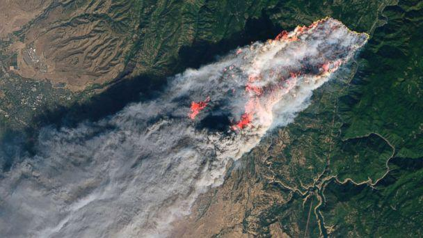 PHOTO: This enhanced satellite image provided by NASA's Earth Observatory, shows a wildfire in Paradise, Calif., on Thursday, Nov. 8, 2018. (NASA via AP)