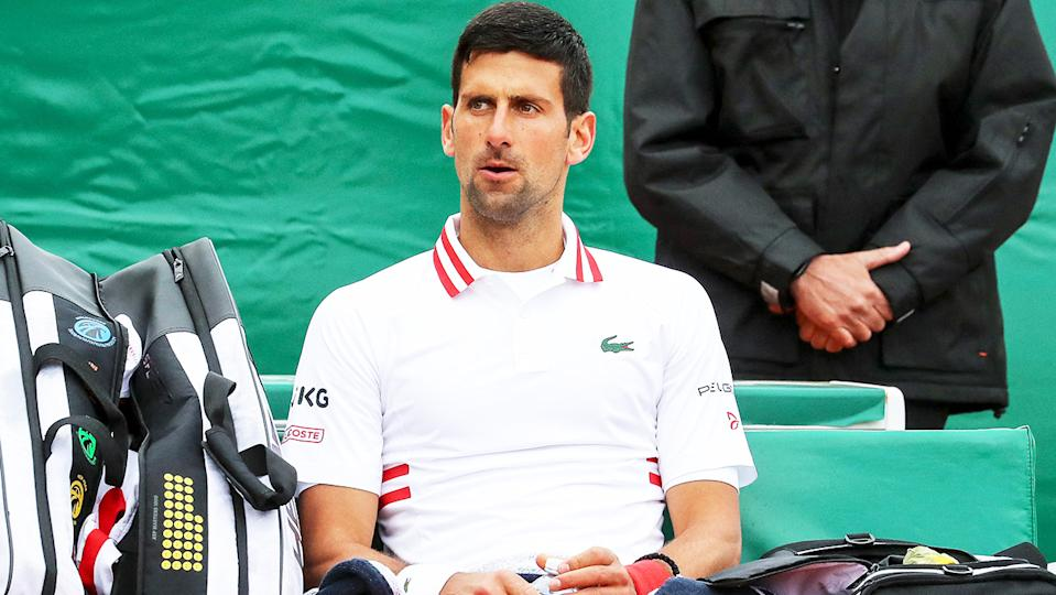 Novak Djokovic (pictured) looking dejected following his loss to Evans.