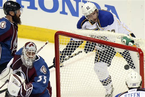 St. Louis Blues' David Backes (42) scores past Colorado Avalanche goalie Jean-Sebastien Giguere (35) during the first period of an NHL hockey game, Sunday, April 21, 2013, in Denver. (AP Photo/Barry Gutierrez)