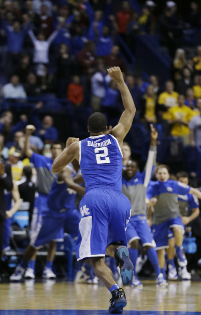 Kentucky guard Aaron Harrison (2) celebrates in the final minutes of a third-round game against Wichita State during the NCAA college basketball tournament Sunday, March 23, 2014, in St. Louis. Kentucky won 78-76. (AP Photo/Jeff Roberson)