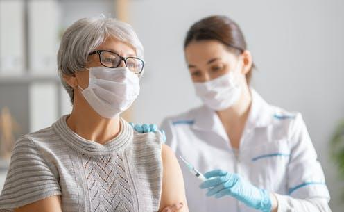 "<span class=""attribution""><a class=""link rapid-noclick-resp"" href=""https://www.shutterstock.com/image-photo/doctor-giving-senior-woman-vaccination-virus-1868898253"" rel=""nofollow noopener"" target=""_blank"" data-ylk=""slk:Yuganov Konstantin/Shutterstock"">Yuganov Konstantin/Shutterstock</a></span>"