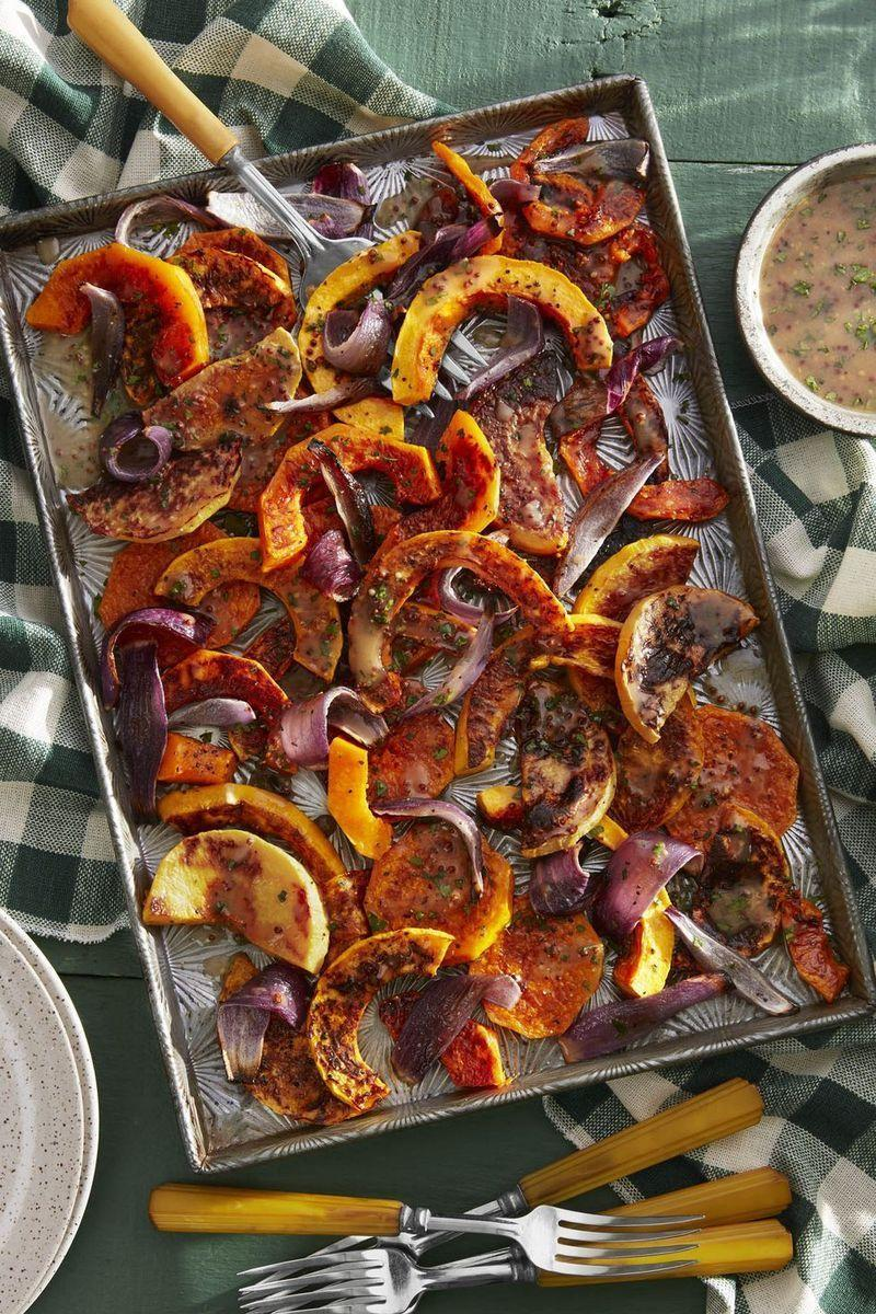 """<p>Butternut squash and onions complement each other for a hearty vegetarian side option. </p><p><strong><a href=""""https://www.countryliving.com/food-drinks/a23367748/roasted-butternut-squash-with-cider-vinaigrette-recipe/"""" rel=""""nofollow noopener"""" target=""""_blank"""" data-ylk=""""slk:Get the recipe"""" class=""""link rapid-noclick-resp"""">Get the recipe</a>.</strong> </p>"""