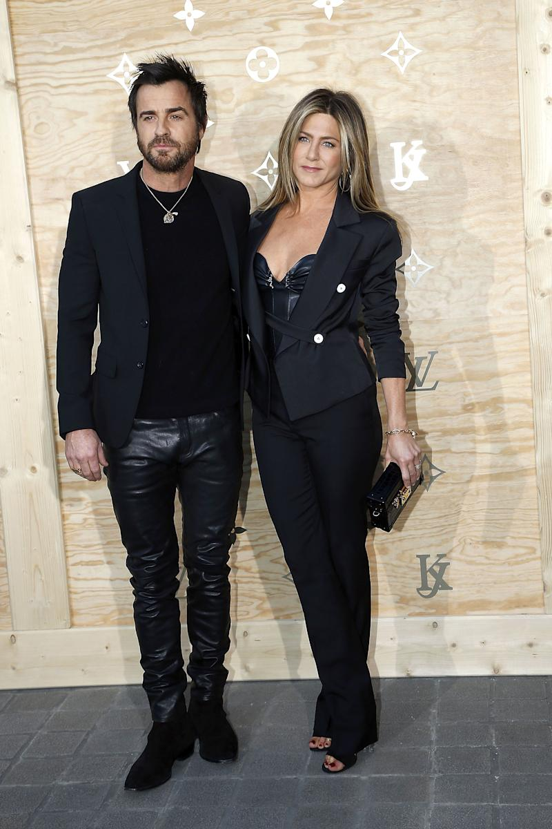 """It's well-documented that Jennifer Aniston <a href=""""https://www.huffingtonpost.ca/entry/jennifer-aniston-style-evolution_us_56ba5a59e4b0c3c5504f36ab"""" target=""""_blank"""" rel=""""noopener noreferrer"""">loves wearing black</a>, and she clearly met her match with Justin Theroux. The couple wore plenty of all-black outfits during their time together, including these looks during an appearance at the Louvre on April 11, 2017."""