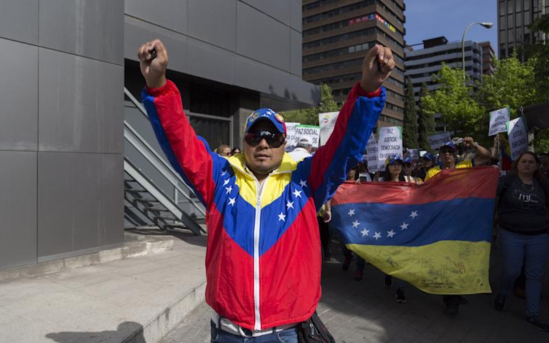 A Venezualan anti-Government protester - Credit: Rex Features