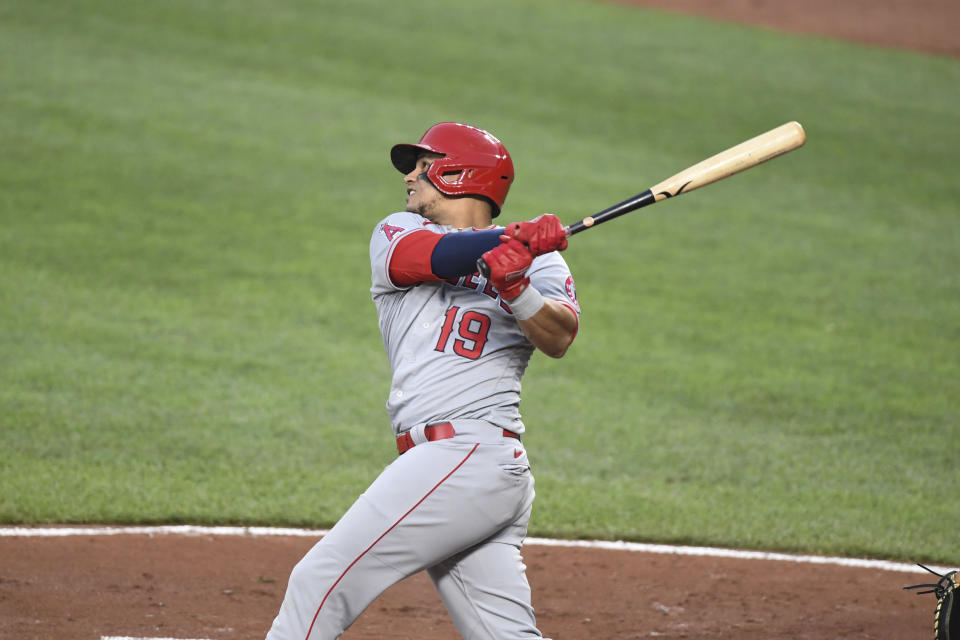 Los Angeles Angels' Juan Lagares (19) watches his two-run home run which scored Los Angeles Angels' Jo Adell hit against Baltimore Orioles starting pitcher Spenser Watkins during the second inning of a baseball game Tuesday, Aug. 24, 2021, in Baltimore. (AP Photo/Terrance Williams)