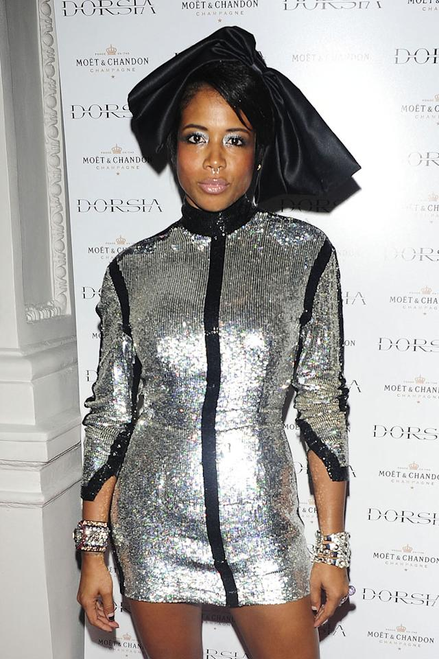 """What's worse, the monstrous black satin bow atop Kelis' head or the blinding, disco ball-inspired dress she sported to the Dorsia Club opening in London? <a href=""""http://www.pacificcoastnews.com/"""" target=""""new"""">PacificCoastNews.com</a> - September 29, 2011"""