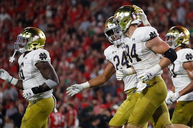 Notre Dame tight end Tommy Tremble (24) celebrates the touchdown of Notre Dame tight end Cole Kmet (84) during the first half of an NCAA college football game against Georgia, Saturday, Sept. 21, 2019, in Athens, Ga. (AP Photo/John Bazemore)