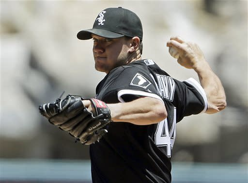 Chicago White Sox starter Jake Peavy pitches to the Los Angeles Angels in the first inning of a baseball game in Anaheim, Calif., Sunday, May 19, 2013. (AP Photo/Reed Saxon)