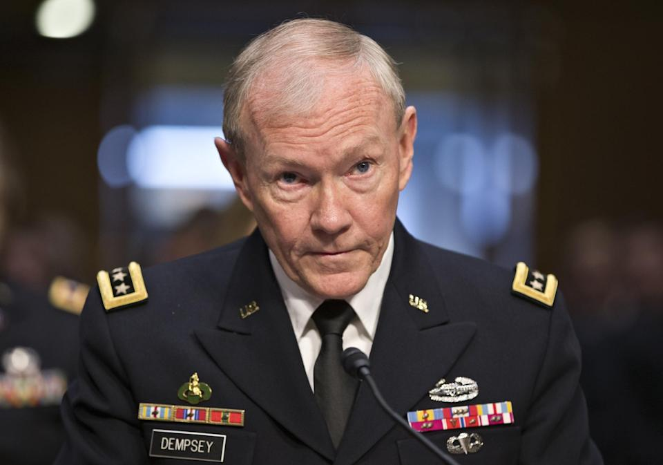 FILE - In this July 18, 2013 file photo, Gen. Martin Dempsey, chairman of the Joint Chiefs of Staff, appears before the Senate Armed Services Committee for a hearing to consider his reappointment to the military's highest post, on Capitol Hill in Washington. Establishing a no-fly zone to protect Syrian rebels would require hundreds of U.S. aircraft at a cost of upward of $1 billion per month and no assurance that it would change the momentum in the 2-year-old civil war, Dempsey said Monday in a cautionary assessment of more aggressive American military action. (AP Photo/J. Scott Applewhite, File)
