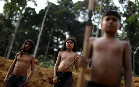"""The president has suggested Brazilian tribes should be taken out of reserves and """"integrated"""" into society - Credit: Ueslei Marcelino/Reuters"""