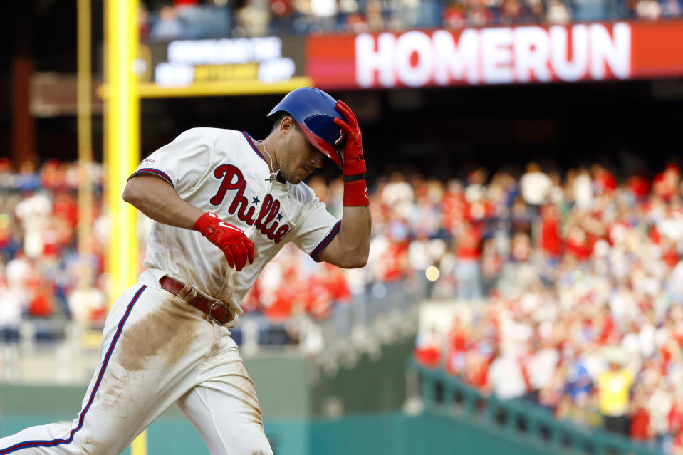 Philadelphia Phillies' J.T. Realmuto rounds the bases after hitting a two-run home run off Atlanta Braves relief pitcher Wes Parsons during the fifth inning of a baseball game, Saturday, March 30, 2019, in Philadelphia. (AP Photo/Matt Slocum)