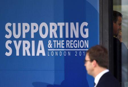 Britain's Prime Minister David Cameron (R) arrives at the donors Conference for Syria in London, Britain February 4, 2016. REUTERS/Toby Melville