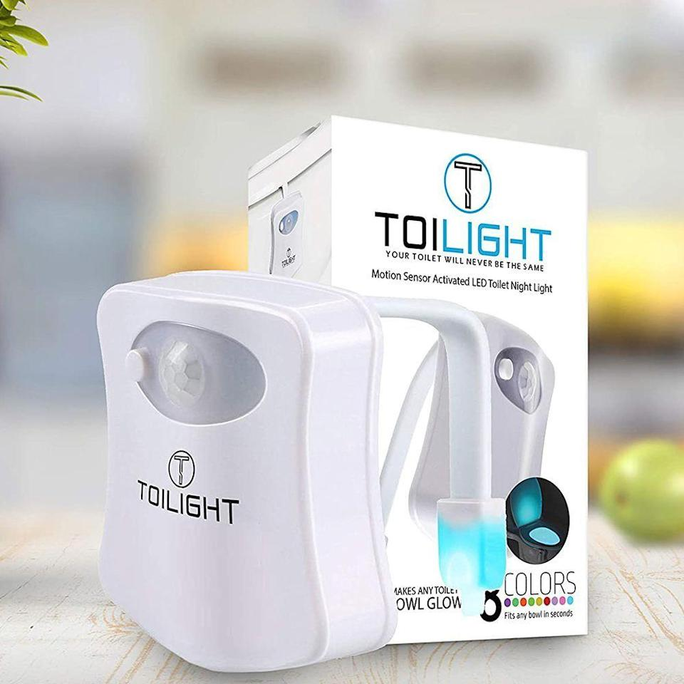"""<p><strong>ToiLight</strong></p><p>amazon.com</p><p><strong>$12.99</strong></p><p><a href=""""https://www.amazon.com/dp/B01HTU9TLY?tag=syn-yahoo-20&ascsubtag=%5Bartid%7C2141.g.29492086%5Bsrc%7Cyahoo-us"""" rel=""""nofollow noopener"""" target=""""_blank"""" data-ylk=""""slk:Shop Now"""" class=""""link rapid-noclick-resp"""">Shop Now</a></p><p>This isn't the most sentimental gift, but it'll keep him from tripping over the bathroom carpet at night. This movement-sensing night light attaches to the toilet and glows in nine different colors.</p>"""