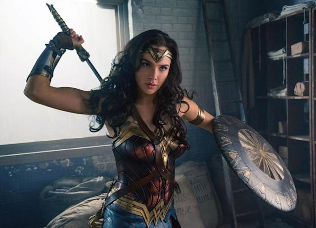 """<p>It seems 2017 has been the year of the woman, and Gal Gadot helped make that the case. The actress nailed it as an Amazonian superhero fighting to save the world from evil. The film — which scored <a href=""""https://www.rottentomatoes.com/m/wonder_woman_2017/"""" rel=""""nofollow noopener"""" target=""""_blank"""" data-ylk=""""slk:an impressive 92 percent"""" class=""""link rapid-noclick-resp"""">an impressive 92 percent</a> on Rotten Tomatoes — was one of Hollywood's top blockbusters. It also won some high-profile support from <a href=""""https://www.yahoo.com/news/22-celebs-react-wonder-woman-172058918.html"""" data-ylk=""""slk:celebrity fans;outcm:mb_qualified_link;_E:mb_qualified_link"""" class=""""link rapid-noclick-resp newsroom-embed-article"""">celebrity fans</a> and inspired one of the year's <a href=""""https://nrf.com/resources/consumer-research-and-data/holiday-spending/halloween-headquarters"""" rel=""""nofollow noopener"""" target=""""_blank"""" data-ylk=""""slk:top Halloween costumes"""" class=""""link rapid-noclick-resp"""">top Halloween costumes</a> for both children and adults. It's no surprise that Gadot's name was one of Google's <a href=""""https://www.aol.com/article/entertainment/2017/12/13/googles-top-searched-actors-in-2017-meghan-markle/23305189/"""" rel=""""nofollow noopener"""" target=""""_blank"""" data-ylk=""""slk:top-searched actors"""" class=""""link rapid-noclick-resp"""">top-searched actors</a> of the year. (Photo: Clay Enos/©Warner Bros. Pictures/courtesy Everett Collection) </p>"""