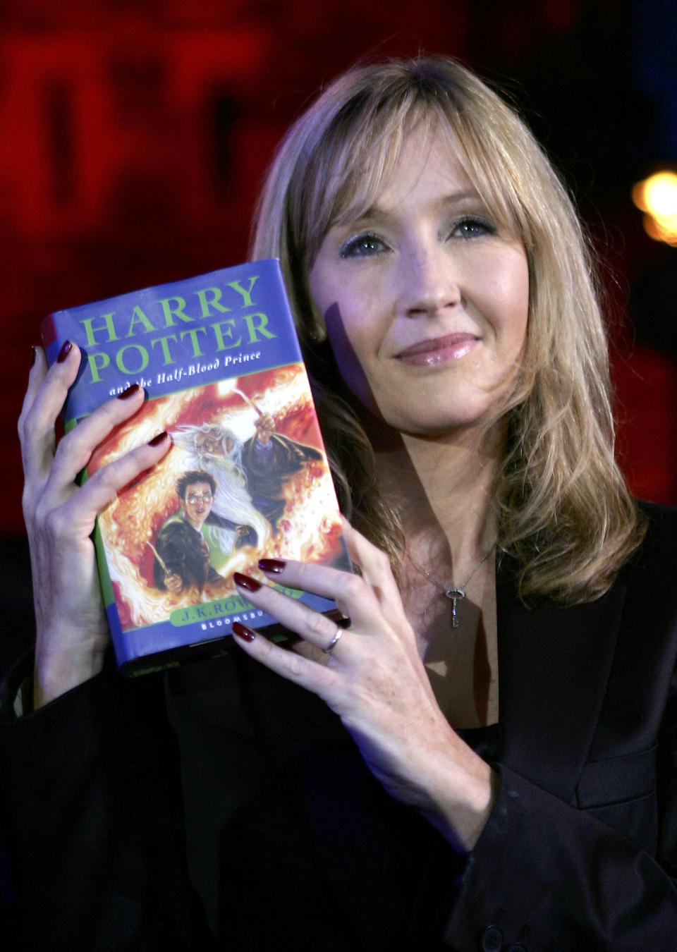 """Harry Potter author JK Rowling arrives at Edinburgh Castle where she will read passages from the sixth magical children's title """"Harry Potter And The Half-Blood Prince"""", on July 15, 2005 in Edinburgh, Scotland. 70 junior reporters from around the world, aged between eight and 16, make up the audience, and meet and ask questions to the author ahead of the midnight release of the new volume. *** Local Caption *** JK Rowling"""