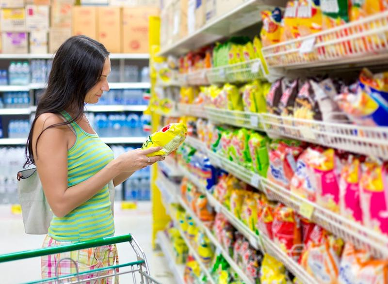 woman shopping grocery store snack aisle
