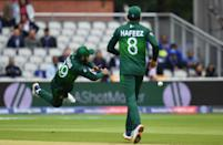 Pakistan's Shadab Khan shows off his athletic fielding (Photo by DIBYANGSHU SARKAR/AFP/Getty Images)