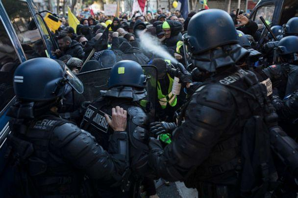 PHOTO: Police use pepper spray during a yellow vest demonstration marking the one year anniversary of the movement in Marseille, southern France, Saturday, Nov. 16, 2019. (Daniel Cole/AP Photo)