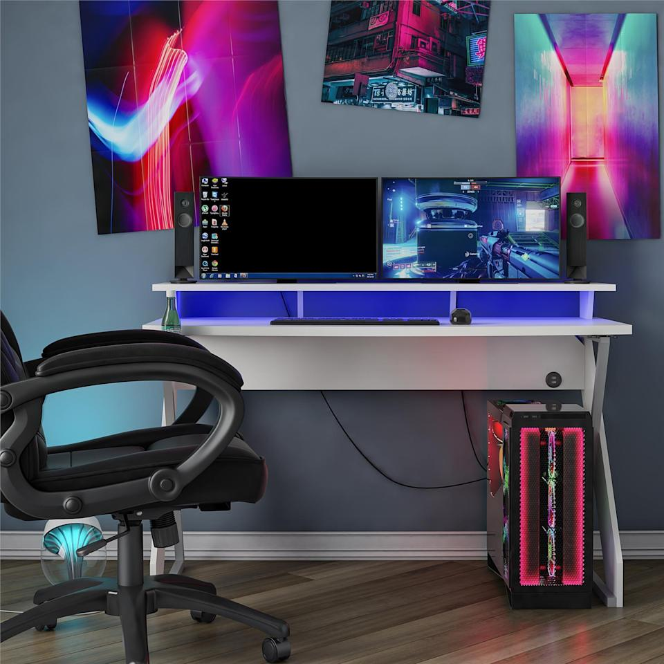 New this summer, Ameriwood Home's NTense Xtreme Gaming Desk ($195.98 for white, $250.19 for black) offers two levels to set up gear, such as placing monitors and speakers on the back riser and the mouse and keyboard on the main level.