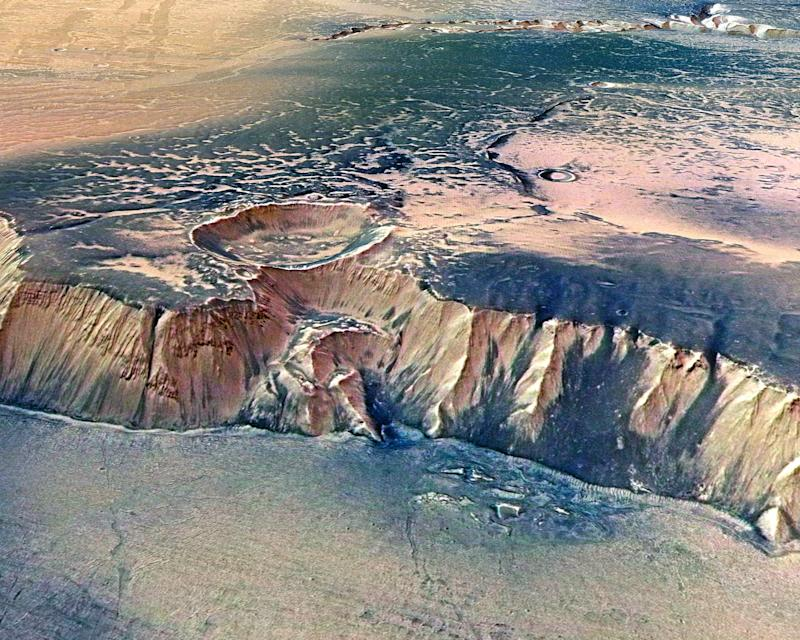 In this handout image supplied by the European Space Agency (ESA) on July 16, 2008, the Echus Chasma, one of the largest water source regions on Mars, is pictured from ESA's Mars Express: Getty Images