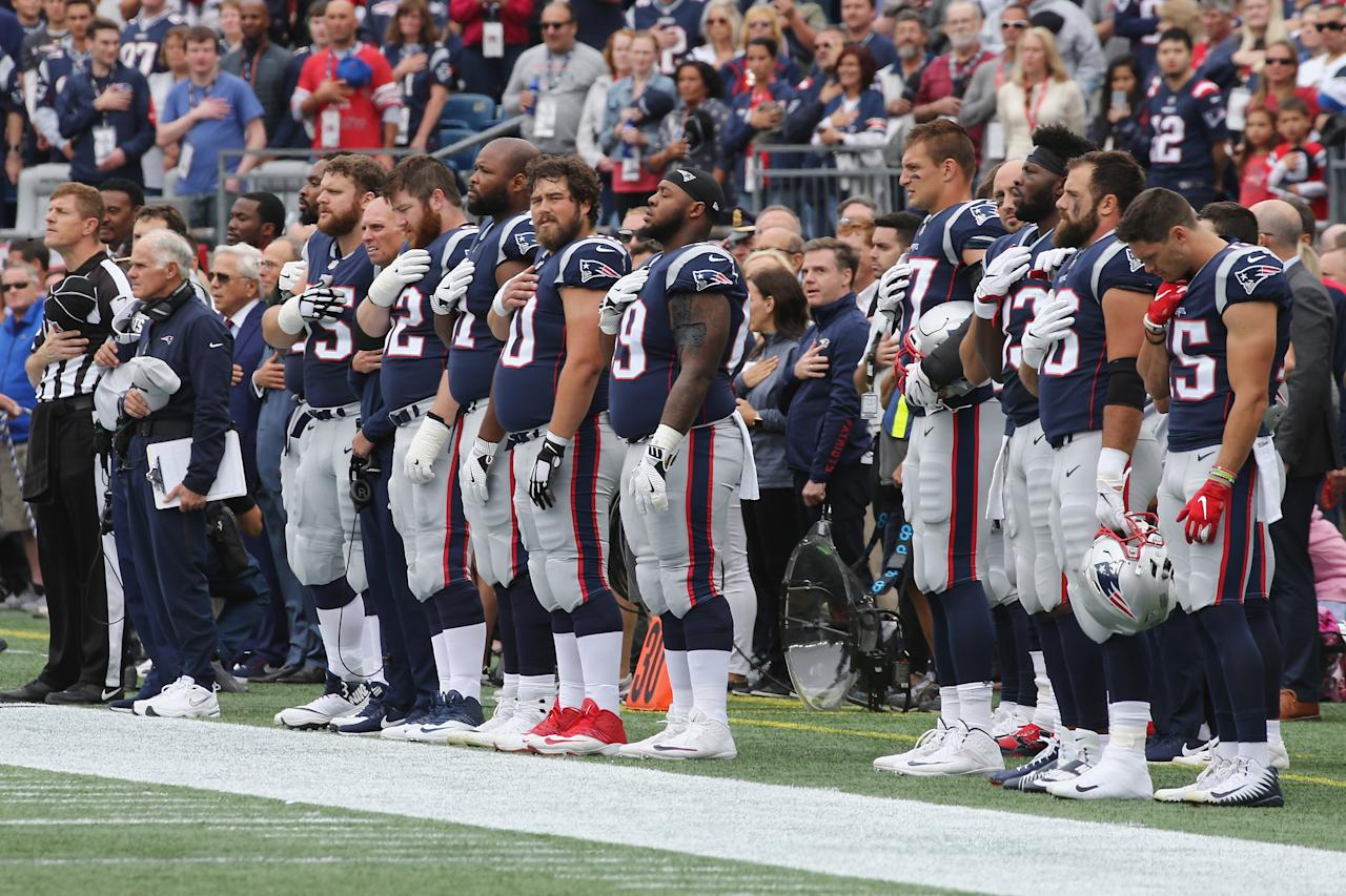 <p>The New England Patriots stand for the national anthem before the game against the Houston Texans at Gillette Stadium on September 9, 2018 in Foxborough, Massachusetts. (Photo by Jim Rogash/Getty Images) </p>