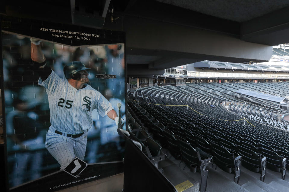 A mural commemorating Jim Thome's 500th career home run is displayed near empty seats before the Chicago White Sox's home opener baseball game against the Minnesota Twins, Friday, July 24, 2020, in Chicago. (AP Photo/Charles Rex Arbogast)
