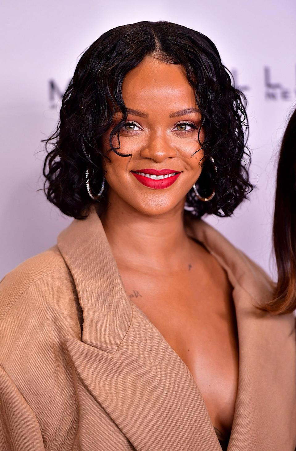 "<p><a class=""link rapid-noclick-resp"" href=""https://www.popsugar.com/Rihanna"" rel=""nofollow noopener"" target=""_blank"" data-ylk=""slk:Rihanna"">Rihanna</a> styled her curly bob to give it the wet look for a New York benefit in 2017.</p>"