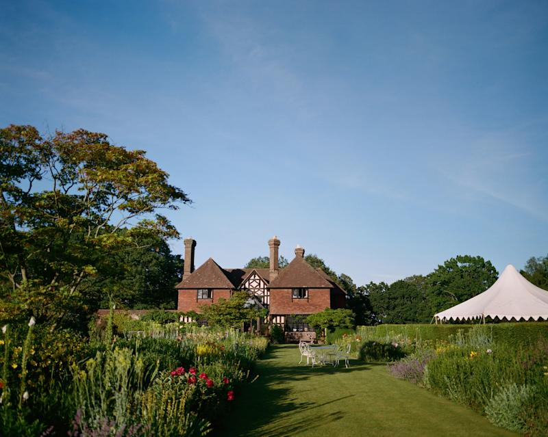 My father's house where the drinks reception took place, with his herbaceous borders in full bloom