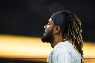 San Diego Padres' Fernando Tatis Jr. reacts after grounding out during the ninth inning of the team's baseball game against the Los Angeles Dodgers, Thursday, Aug. 26, 2021, in San Diego. (AP Photo/Gregory Bull)