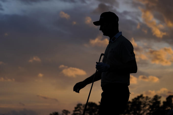 Justin Rose, of England, walks on the 18th green during the third round of the Masters golf tournament on Saturday, April 10, 2021, in Augusta, Ga. (AP Photo/David J. Phillip)