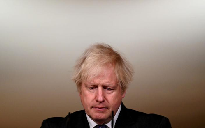 Boris Johnson and ministers are considering plans to open the economy by mid-summer - Reuters