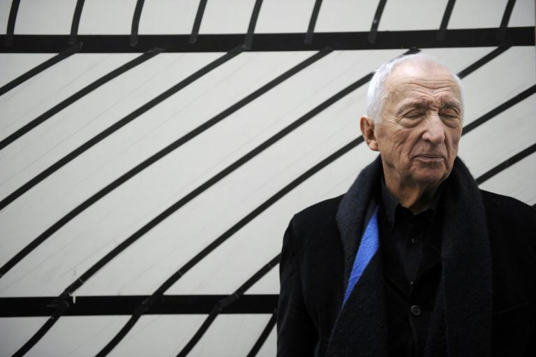 Pierre Soulages, who turns 100 years old this month, in front of one of his pieces in 2010 (AFP Photo/ANNE-CHRISTINE POUJOULAT)
