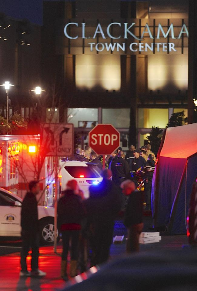 Police and medics outside the scene of a multiple shooting at Clackamas Town Center Mall in Clackamas, Ore., Tuesday Dec. 11, 2012. A gunman is dead after opening fire in the Portland, Ore., area shopping mall Tuesday, killing two people and wounding another, sheriff's deputies said. (AP Photo/Greg Wahl-Stephens)