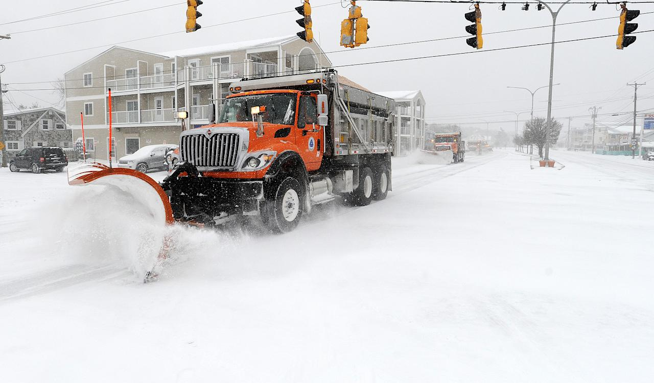 DelDot plows Coastal Highway through Dewey Beach, Del. on Monday, March, 3, 2014. Gov. Jack Markell says he will left a state of emergency and driving warning in Kent and Sussex counties, but urged motorists to exercise caution as a winter storm continued to dump snow on the mid-Atlantic region. (AP Photo/The Wilmington News-Journal, Chuck Snyder) NO SALES