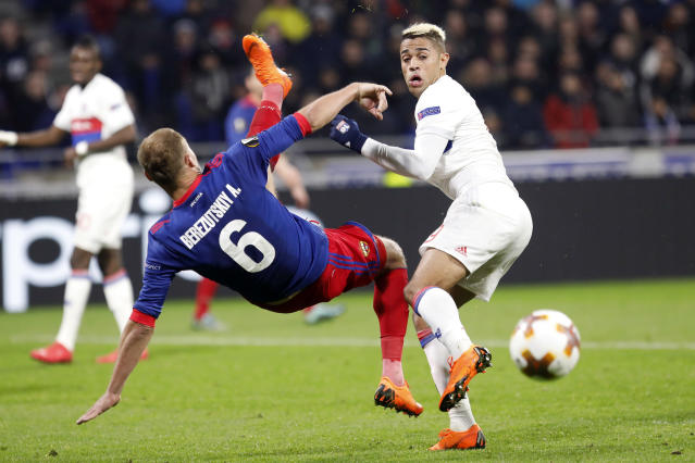 CSKA's Aleksei Berezutski, left, challenges for the ball with Lyon's Mariano Diaz during the Europa League, round of 16 second leg soccer match between Lyon and CSKA Moscow in Decines, near Lyon, central France, Thursday March 15, 2018. (AP Photo/Laurent Cipriani)