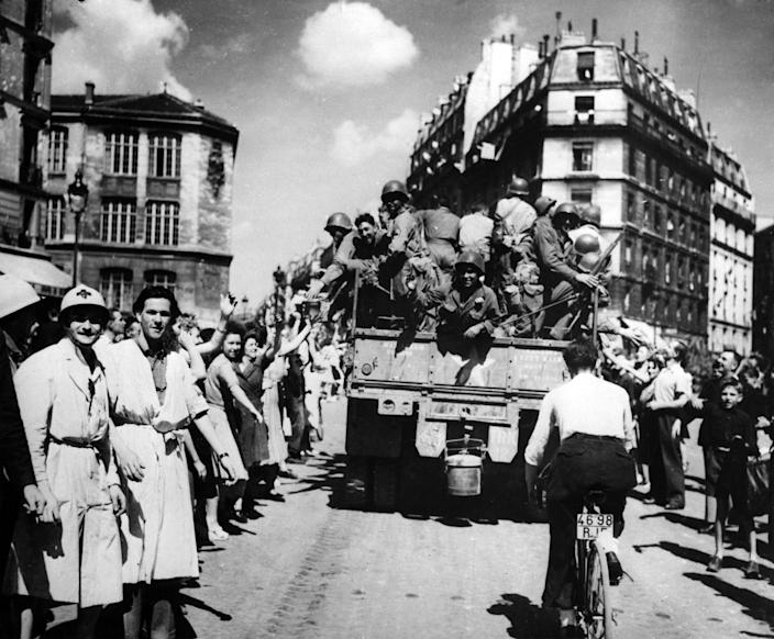 The liberation of Paris, August 1944. Jubilant crowds take to the streets to welcome their Allied liberators.