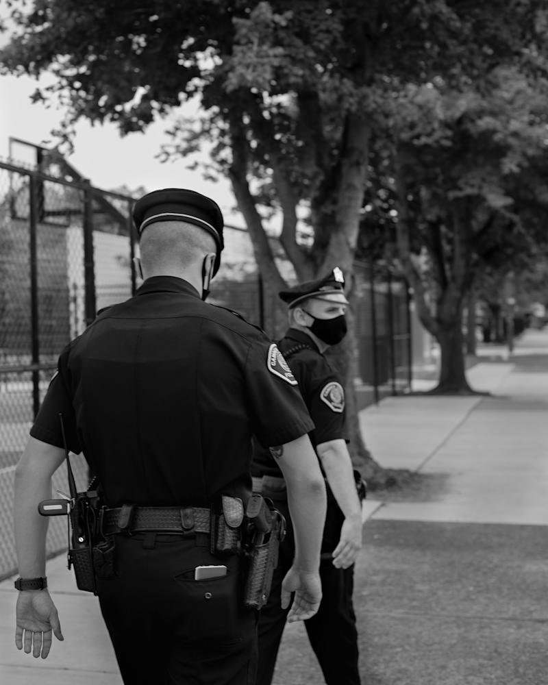 In 2013, when the Camden Police department relaunched under county control, it had two main objectives: reduce the crime rate, and make citizens feel safer. Above, two officers patrol the streets of the city on July 17. | Widline Cadet for TIME