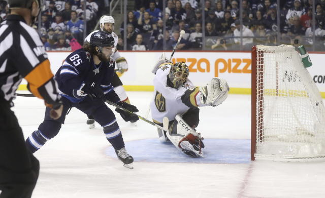 Winnipeg Jets' Mathieu Perreault (85) scores on Vegas Golden Knights goaltender Marc-Andre Fleury (29) during the second period of an NHL hockey game Tuesday, Jan. 15, 2019, in Winnipeg, Manitoba. (Trevor Hagan/The Canadian Press via AP)