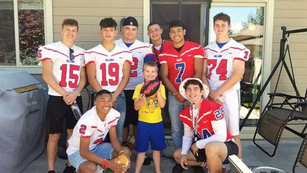 PHOTO: Local football team surprises Christian on his birthday. (Lindsay Barrus Larsen)