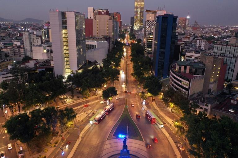 Light traffic travels on Mexico City's Reforma Avenue
