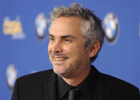 Director Alfonso Cuaron, a nominee, poses at the 66th annual Directors Guild of America Awards in Beverly Hills, California January 25, 2014. REUTERS/Gus Ruelas