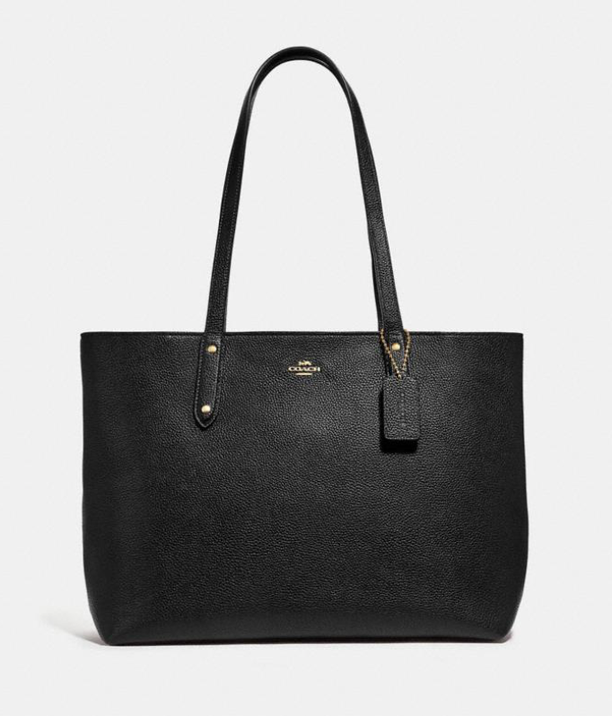 This tote is made with scratch-resistant pebbled leather and features a zip-top closure. (Photo: Coach)