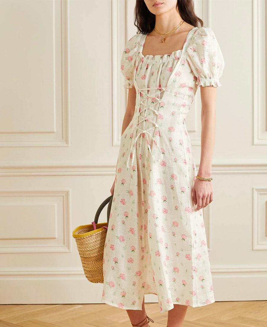 """Found: Your uniform for lounging in a flower field. $290, Net-a-Porter. <a href=""""https://www.net-a-porter.com/en-us/shop/product/sleeper/marquise-lace-up-floral-print-linen-midi-dress/1242556"""" rel=""""nofollow noopener"""" target=""""_blank"""" data-ylk=""""slk:Get it now!"""" class=""""link rapid-noclick-resp"""">Get it now!</a>"""