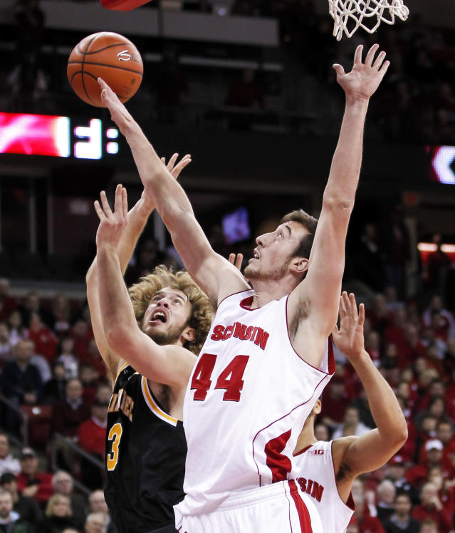 Wisconsin's Frank Kaminsky (44) blocks a shot by Milwaukee's Kyle Kelm during the first half of an NCAA college basketball game on Wednesday, Dec. 11, 2013, in Madison, Wis. (AP Photo/Andy Manis)
